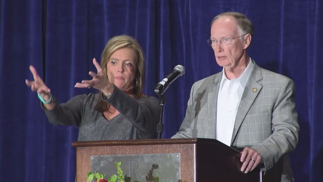 Rebekah Mason illustrating Governor Bentley's breast grab...