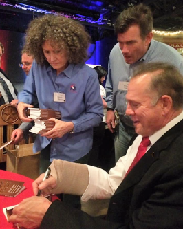 Judge Roy Moore autographing bibles in Texas with his injured arm.